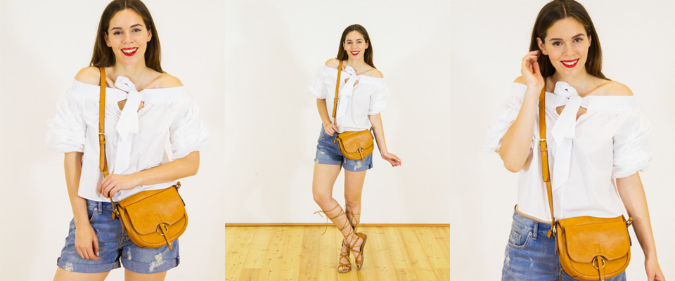 top bianco e shorts di jeans